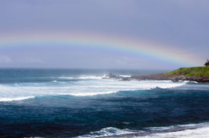 photo of ocean with rainbow