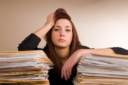 Woman with stacks of papers